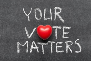 your vote matters phrase handwritten on blackboard with heart symbol instead of O